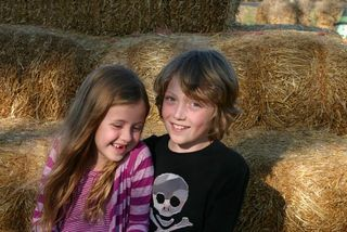 Kids together haybales